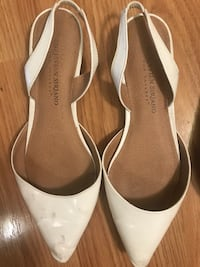 pair of white leather heeled sandals North Vancouver, V7K 2H4