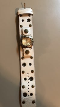 Gold Fossil analog watch with white leather band