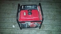 red and black portable generator 3748 km