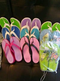 three pairs of assorted color flip flops
