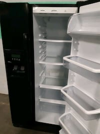 WHIRLPOOL SIDE BY SIDE DOORS FRIDGE WORKING PERFECTLY  Baltimore, 21201