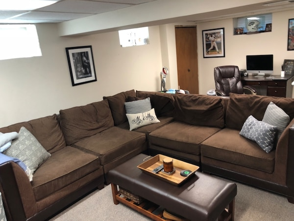 Used Brown microfiber sectional sofa with throw pillows for sale in ...