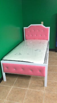 FURNITURE SALE , BRAND NEW PINK TWIN METAL BE AND TWIN MATTRESS NEW IN BOX  WE FINANCE NO CREDIT NEEDED