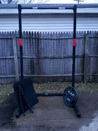 Squat Rack / Pull Up bar, includes one 45lb weight and mats