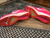 Pair of pink nike running shoes Tacoma, 98408