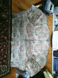 gray and multicolored floral fabric loveseat sofa