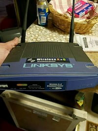 black and blue Linksys wireless router modem Queens, 11419