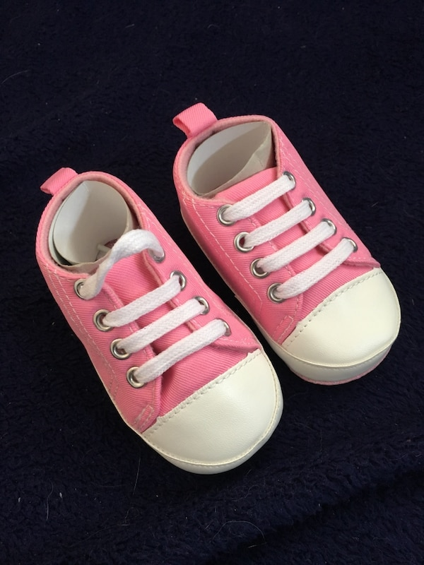 pair of white-and-pink low top sneakers