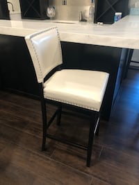 White faux leather bar stool.  Bar height. 4 of them.  New.  In box. $85 a piece Odenton, 21113