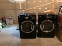 two black front-load clothes washer and dryer set