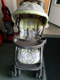 baby's gray and green Graco stroller Brighton