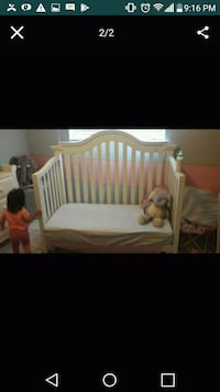 baby's white wooden crib 945 mi