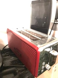 red and stainless steel 2-slot bread toaster