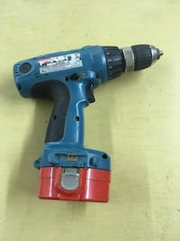 Makita cordless drill 14.4 drill charger and battery and flashlight.