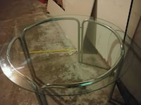 round clear glass top table with gray metal base Columbus, 43230