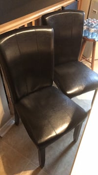 black leather padded rolling armchair London, N6L 0A1