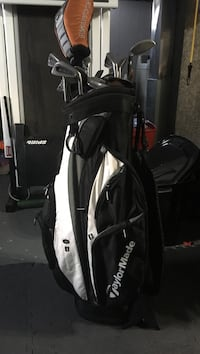white and black Taylormade golf bag