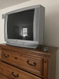 gray CRT television with brown wooden TV stand Kenosha