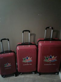 three red Canada 150 hard shell luggages London, N6C 5T7