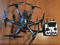 Black and gray quadcopter drone with controller Montréal, H1Y 2S7
