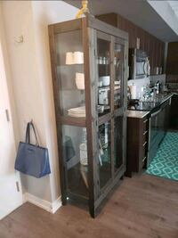 brown wooden framed glass display cabinet Toronto, M6H 0B6