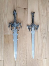 two black and gray metal swords Edmonton