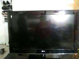 36in. LG TV with a 38in. table and a Google Chromecast