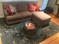 brown fabric sectional sofa with throw pillows null