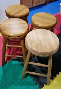 4 solid oak swivel bar stools from country woods. Manchester, 03103