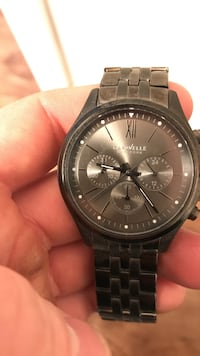 round black Michael Kors chronograph watch with link bracelet
