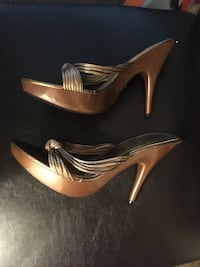 Pair of brown leather pointed-toe pumps size 9 Calgary, T2N 4K3