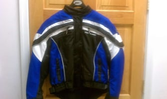 blue, white, and black motorcycle jacket