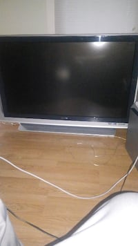 """black and silver 55"""" projection tv"""