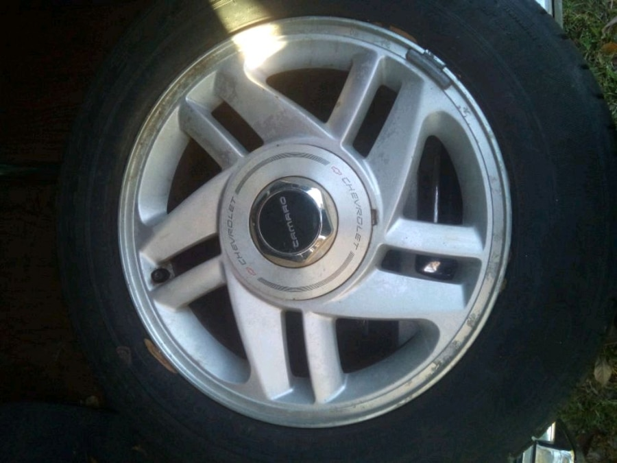 Photo 2-chevy rims with GOOD TIRES ONLY ONE RIM HAVE CENTER CAP.