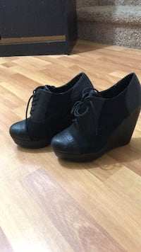 pair of black leather chunky heeled booties Edmonton, T6T 1Z3