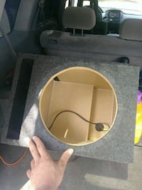 gray and brown subwoofer enclosure