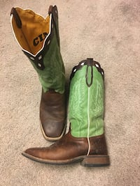 pair of green-and-brown leather cowboy boots 323 mi