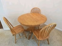 Round wooden table with 3 chairs included  Richmond, 77469