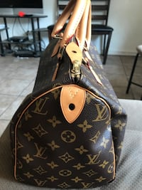 Brown and black louis vuitton leather tote bag Visalia, 93291