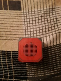 red and black portable speaker 750 mi