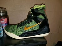 pair of green-and-black Nike basketball shoes McMinnville, 37110