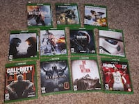 assorted Xbox One game cases ROY