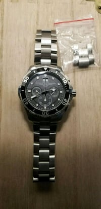 round black chronograph watch with silver link bracelet Mississauga, L5M 3T9