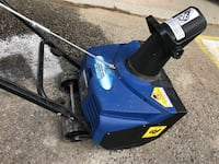 Blue and black snow blower