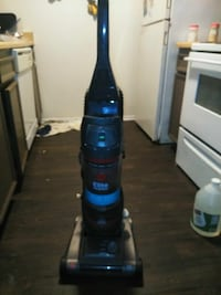 black and blue Bissell upright vacuum cleaner Bakersfield, 93301
