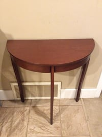brown wooden round top table