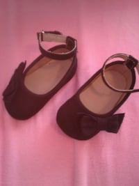 pair of girl's black ankle strap flat shoes