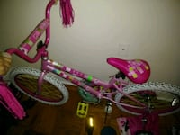 toddler's pink and white bicycle with training wheels Riverdale Park