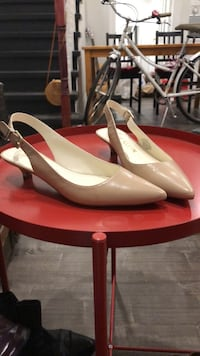 pair of red leather pointed-toe pumps Toronto, M4V 2G8