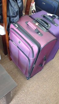 two purple and pink soft case luggage Columbus, 43228